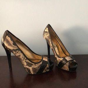 """Likely worn Guess heels. 4"""" heel."""